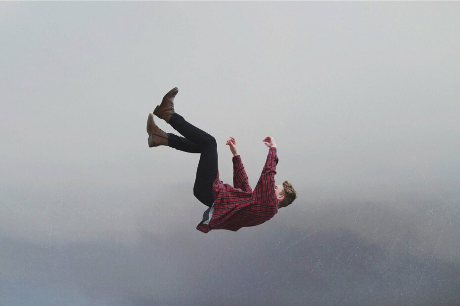 a person falling, caught midair